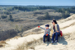 Mother and son together on sand Dunes in Neringa Royalty Free Stock Photos