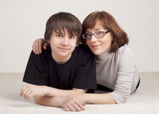 Mother and son are together and smile. In studio royalty free stock photo