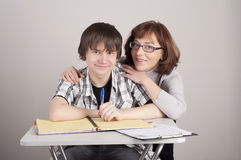 Mother and son are together and smile. In studio royalty free stock photos