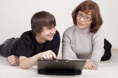 Mother and son are together, work with computer Stock Image