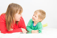 Mother and son with touch pad Stock Images