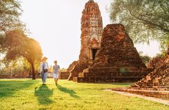 Mother and son tourists walking hand in hand in atcient Wat Chaiwatthanaram Buddhist temple ruines in holy city Ayutthaya,. Thailand  in Auyttaya stock photos