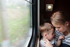 Mother and son on a train trip Royalty Free Stock Images