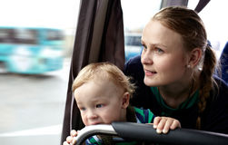 Mother and son travel by bus. Royalty Free Stock Photography