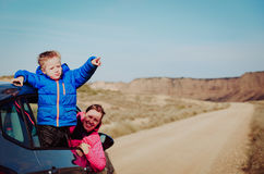 Mother and son travel by car in mountains Royalty Free Stock Photo