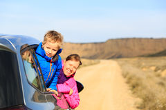 Mother and son travel by car in mountains Royalty Free Stock Photos