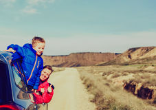Mother and son travel by car on road to mountains Royalty Free Stock Photo