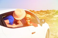 Mother and son travel by car in summer mountains Royalty Free Stock Images