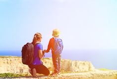 Mother and son travel in mountains on summer Stock Images