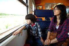 Mother and son travel in the train Royalty Free Stock Photos