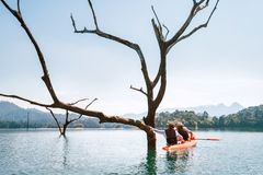 Mother and son travelers explore the Cheow Lan lake in Thailand stock photos