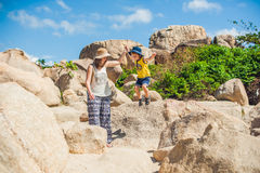 Mother and son travelers at the Hon Chong cape, Garden stone, popular tourist destinations at Nha Trang. Vietnam. Asia Travel concept. Journey through Vietnam Stock Image