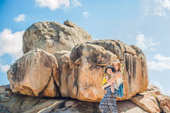 Mother and son travelers at the Hon Chong cape, Garden stone, popular tourist destinations at Nha Trang. Vietnam. Asia Travel concept. Journey through Vietnam Stock Photography