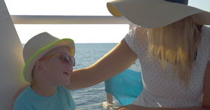 Mother and son traveling by ship stock video footage