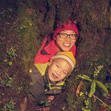Mother son in tree hole Royalty Free Stock Photography