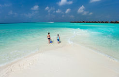 Mother and son at tropical beach. Above view of  mother and son walking at tropical beach with snorkeling equipment Stock Photos