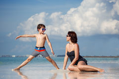 Mother and son on tropical beach Royalty Free Stock Image