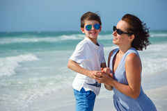 Mother and son on tropical beach Royalty Free Stock Photos