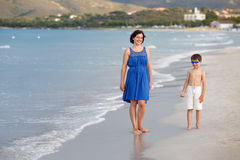 Mother and son on tropical beach Stock Photo