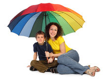 Mother and son with umbrella sitting isolated Stock Photo