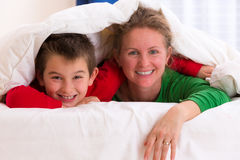 Mother and Son Under Blanket Royalty Free Stock Image