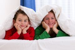 Mother and Son Under Blanket Stock Photo