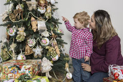 Mother and son under Christmas tree Stock Photography