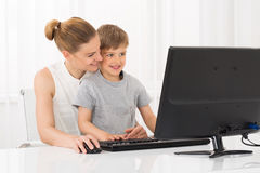 Mother And Son Using Computer Stock Photos