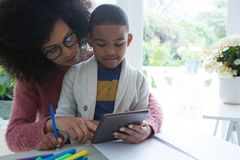 Mother and son using digital tablet. At home Royalty Free Stock Image
