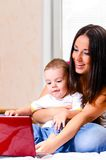 Mother and son are using laptop. At home Stock Photos