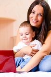 Mother and son are using laptop Royalty Free Stock Photos