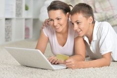 Mother and son using laptop. Online shopping concept Stock Photos