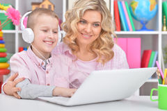Mother and son using laptop Stock Photography