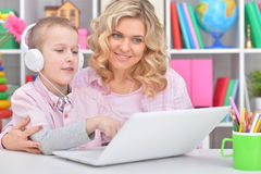 Mother and son using laptop Royalty Free Stock Photo