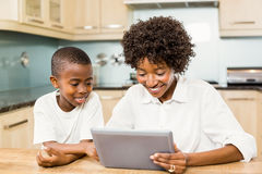 Mother and son using tablet Royalty Free Stock Photography