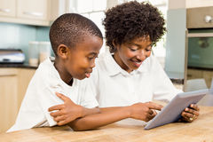 Mother and son using tablet Stock Image