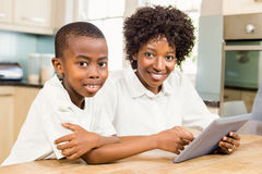 Mother and son using tablet Royalty Free Stock Images