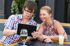 Mother and son using a tablet talk Royalty Free Stock Photo