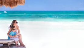 Mother and son on vacation. Panoramic photo of mother and son at tropical beach in Tulum Mexico Stock Photos