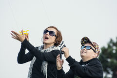 Mother and son venturing kite. Leisure activity Stock Photography