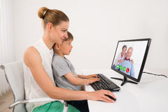 Mother And Son Videoconferencing Royalty Free Stock Photography
