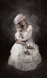 Mother and Son Vintage. Mother and son in vintage victorian era attire royalty free stock photo