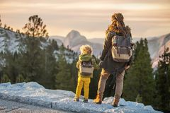 Mother with toddler visit Yosemite national park in California, USA.  royalty free stock photography