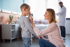 Mother and son visiting doctor Stock Image