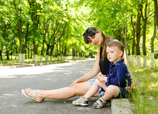 Mother and son waiting in a rural street Royalty Free Stock Image