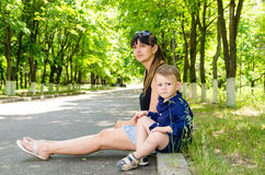 Mother and son waiting in a rural street Stock Images