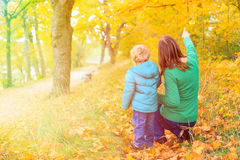 Mother and son walk in autumn Royalty Free Stock Photos