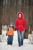 Mother with son walk in forest Royalty Free Stock Images