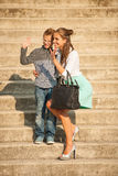 Mother and son walk on stairs in city on late summer afternoon Stock Image