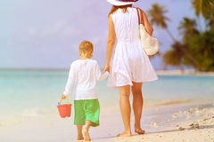 Mother and son walk on summer beach Royalty Free Stock Photos